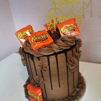 Chocolate buttercream and drip Reese's themed birthday cake