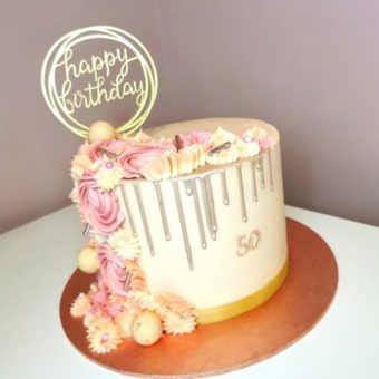 Cream and pink with silver drip 50th birthday cake decorated with iced flowers