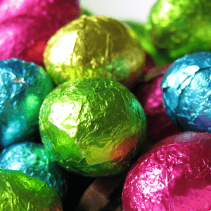 Bright pink, blue, gold and green foil covered small easter eggs