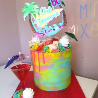 Tall buttercream multicoloured Club Tropicana themed 60th birthday cake