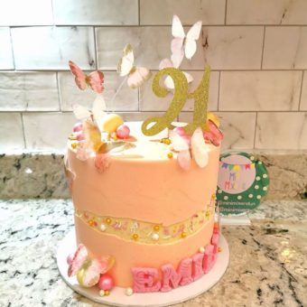 Pink and cream butterfly faultline 21st birthday cake
