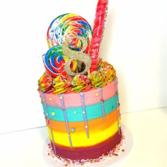 Tall rainbow themed buttercream 8th birthday cake