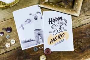 Wooden table with father and child photo and fathers day card